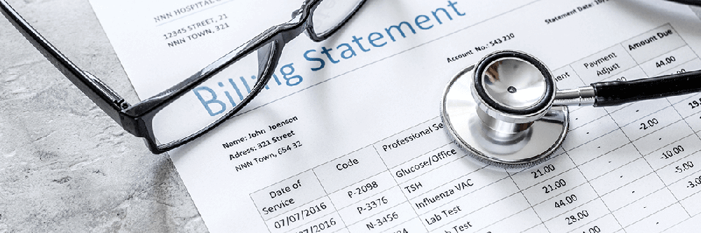 Healthcare billing statement with glasses and stethoscope.