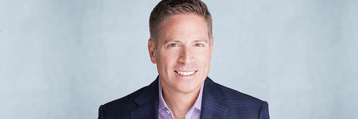 headshot of R1's chief commercial officer, Gary Long