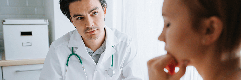 Male physician talking to female patient