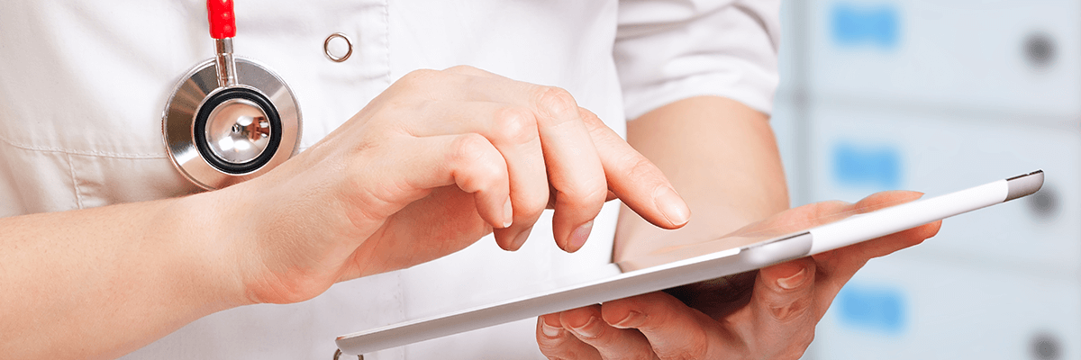 Physician hand scrolling through tablet