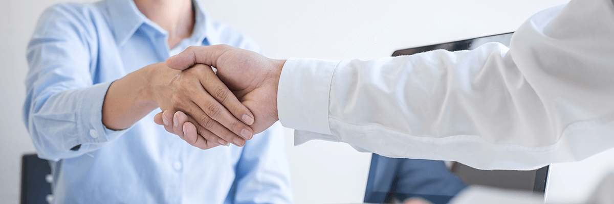 Physician shaking patient's hand