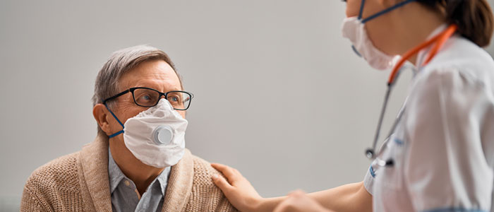 Doctor treating hospital patient in post-COVID health system