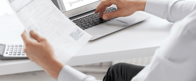 doctor on laptop working on clinical documentation