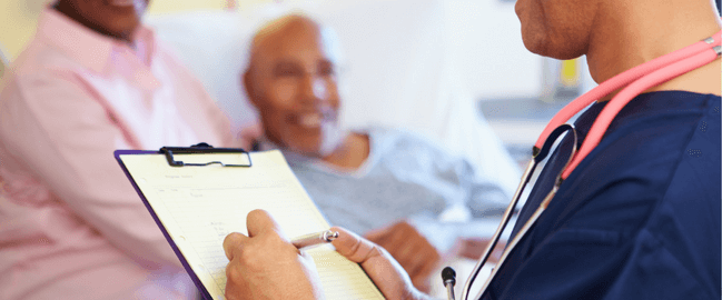 physician makes notes for clinical documentation of COVID-19 patient being treated in hospital