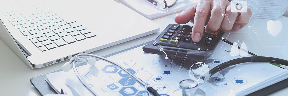 Doctor using calculator.
